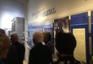 Visitors viewing a museum exhibit